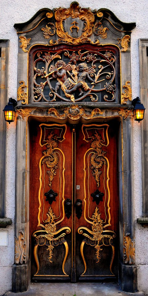 Doors as art. An old wooden door with gold ornaments in old city Gdansk, Poland