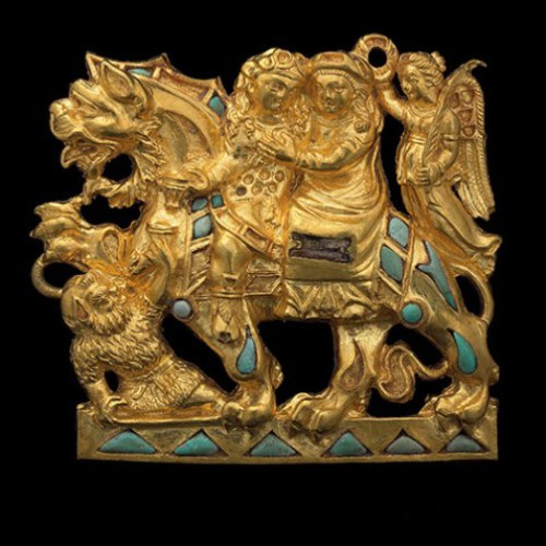 Belt buckle made of gold and turquoise. It depicts Dionysus and Ariadne riding a lion. Found in the burial ground No. 4 of Tillia-Tepe, age 1century BC