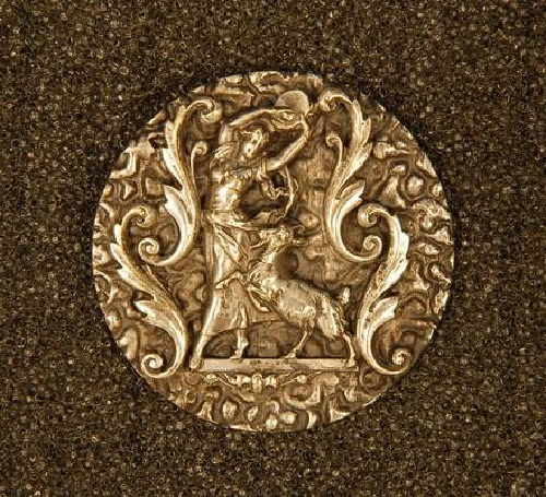 Button 'Esmeralda and her dancing goat'. Copper, silver