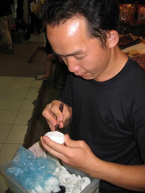Thai craftsman carving soap to create a flower