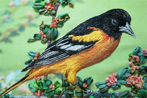 Closeup of Baltimore Oriole. Realistic embroidery by Elza