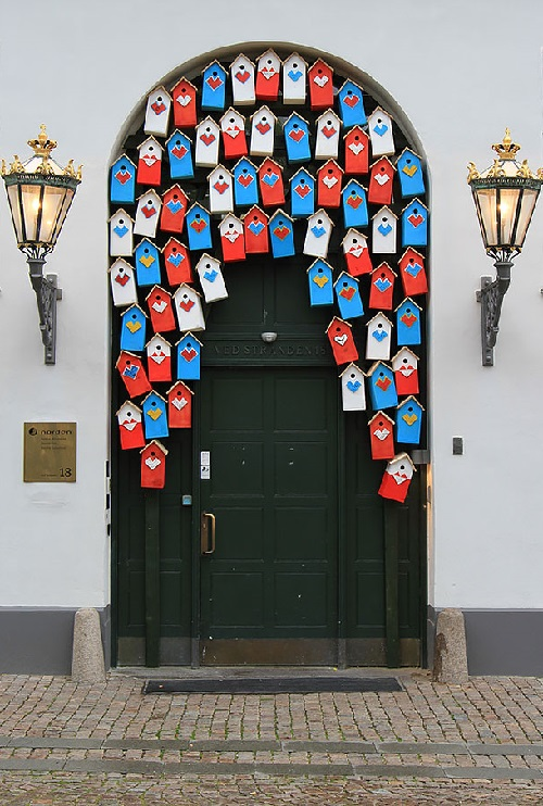 Doors as art. Door decorated with colorful birdhouses in Copenhagen, Denmark