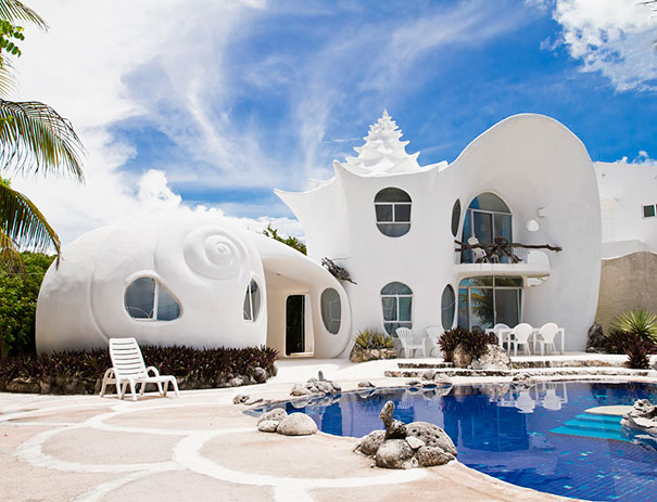 Fairy-tale cottage in Mexico. The original design of the house is in a maritime style. Everything reminds seashells