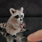 Raccoon. Hand-made miniature sculpture by American self-taught artist Reve