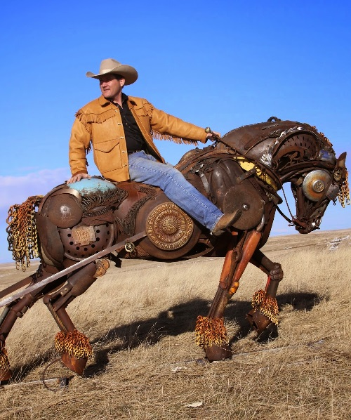 South Dakotan sculptor John Lopez taking a ride on Black Hawk