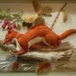 Red squirrel. Stumpwork embroidery by Belgian artist of applied art Christine Paris