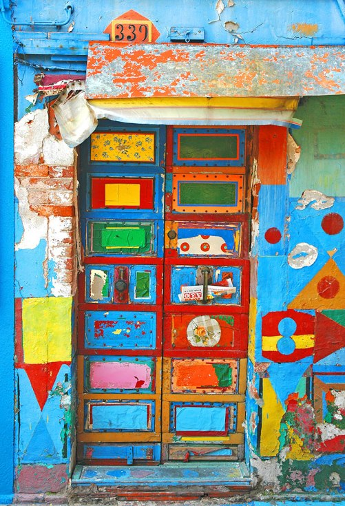 The colorful door in Burano, Italy