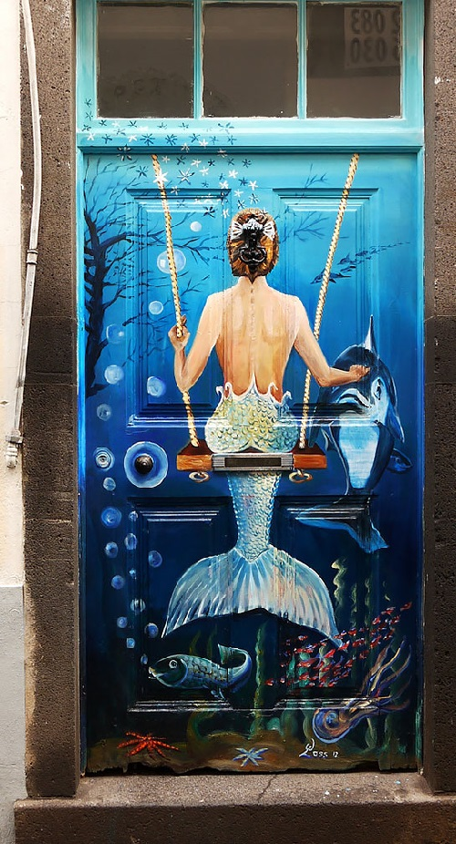 The door with a painted mermaid on it. Portuguese Rua de Santa Maria street in Funchal, Madeira