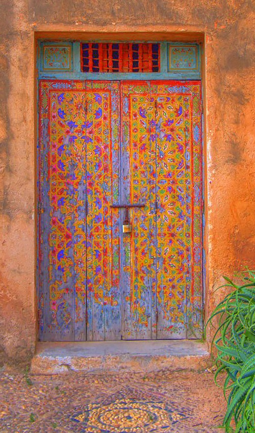 Traditional blue door with painted on it decoration in Fes, Morocco