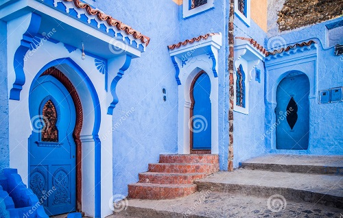 Traditional blue-painted doors in Chefchaouen's old town, Morocco