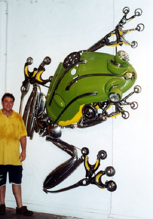 Wall frog. Metal sculpture by James Corbett