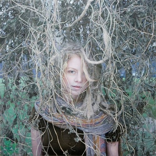Hyperrealistic female portrait painted in oil by Israeli artist Yigal Ozeri
