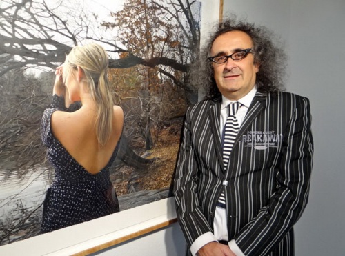 Yigal Ozeri next to his painting