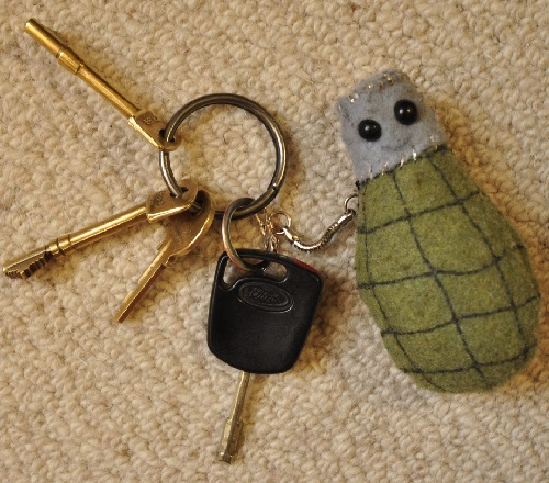 Handmade Felt Grenade Keyrings by British textiles artist Lucy Sparrow