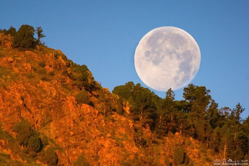 Honey Moonset Over Red Rocks. American photographer John De Bord
