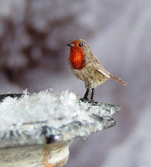 Robin Redbreast made from polymer clay and feathered with hand painted markings. Miniature Wildlife sculpture by British artist Anya Stone