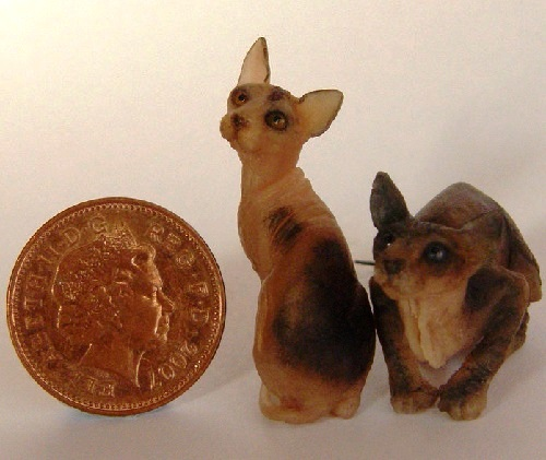 Sphinx cats. Miniature Wildlife sculpture by British artist Anya Stone