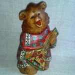Bogorodskaya toy bear with balalaika, carved by hand from a single piece of linden, sculpture slightly aged