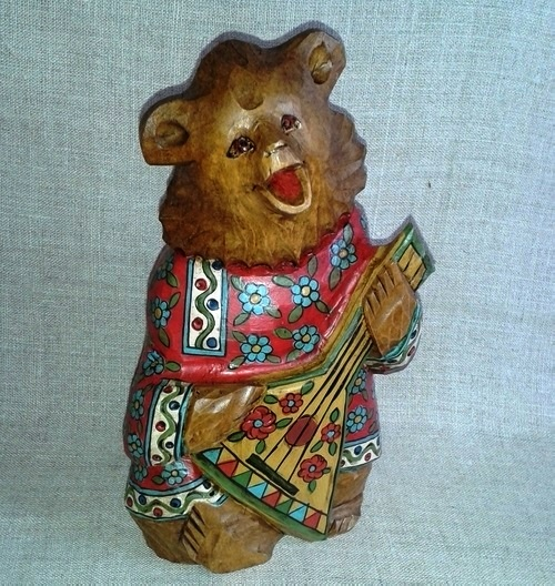 Bogorodskaya toy bear with balalaika, carved by hand from a single piece of linden. Hand-painted cotton shirt, sculpture slightly aged