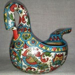 Bucket swan carved by hand from a single piece of wood