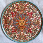 Decorative plate cut from wood. Hand-painted in the style of the Northern Dvina. Surface of plate artificially aged with cracks effecte-luna