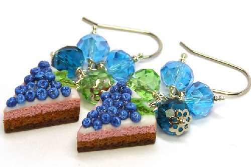 Earrings - pieces of chocolate cake with blueberries. Decoration completed with glass beads that shimmer invitingly in the sun