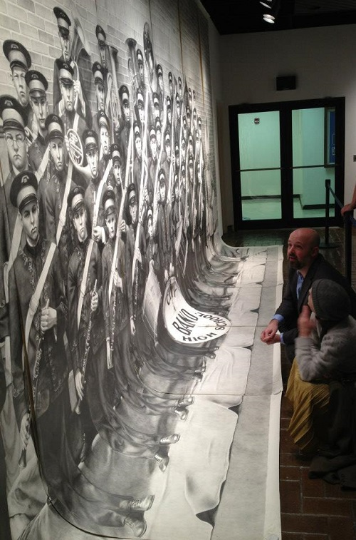 American artist Chris LaPorte next to his pencil drawing. Asheville, North Carolina