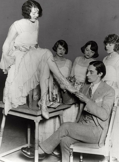 Painting on legs to create the illusion of stockings, retro photo of early XX century, USA