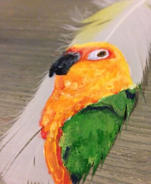 Parrot. Painting on feather by American self-taught artist Jamie Homeister