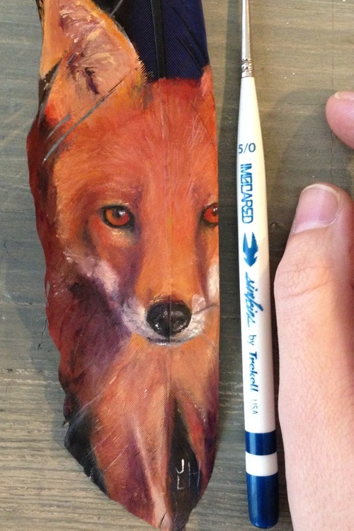The red fox. Painting on feather by American self-taught artist Jamie Homeister