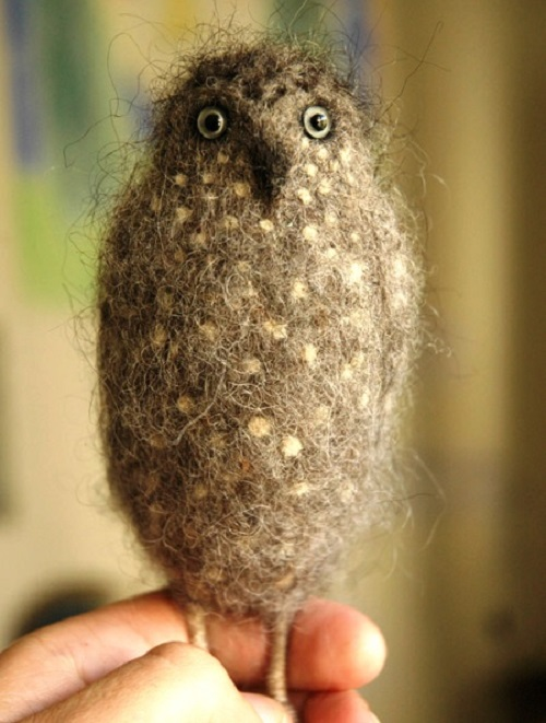 An owlet needle felted from wool. Needle felted animals by Russian craftsman Victor Dubrovsky