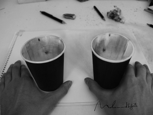 real cup (left) and 3D cup (right). Three dimensional pencil drawing by Syrian artist Muhammad Ejleh