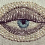 Eye brooch made in a traditional goldwork technique by Japanese artist Azumi Sakata