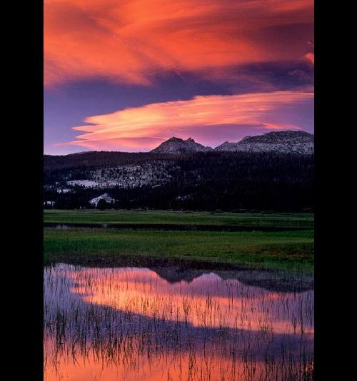 Lenticular cloud at sunset over Ragged Peak and Toulumne Meadows, Tioga Pass Road, Yosemite National Park, California