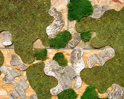 Moss graffiti art by Hungarian eco artist Edina Tokodi