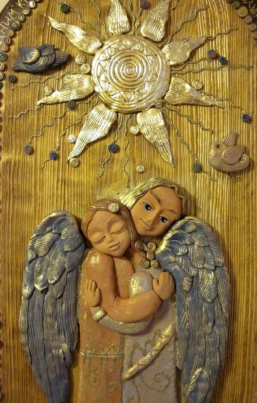 Keramo Mano ceramic art studio. Panels for lovers, handwork. The inscription on the panel - 'each of us is an angel with only one wing, and we can fly only embracing each other'