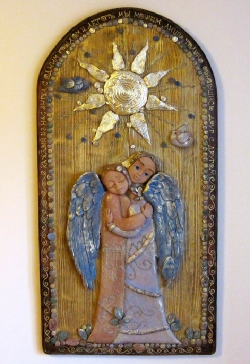 Panels for lovers. The inscription on the panel - 'each of us is an angel with only one wing, and we can fly only embracing each other'. Keramo Mano ceramic art studio