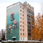 The house decorated with an impressive mural 'Blossom'. Nizhny Novgorod, Russia. Work by street artist Rustam Salemgarayev, aka Qbic