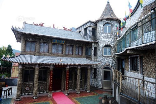 Traditional Chinese house decorated with seashell mosaics. Creation by a self-taught architect Xiao Yongsheng