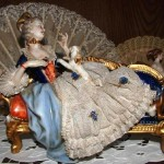 High society lady with a dog. lace porcelain figurines