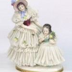 Louis XIV style lace porcelain figurines