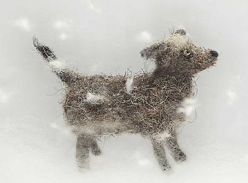 A dog in the snow. Miniature felted toys by Marina Nikitina