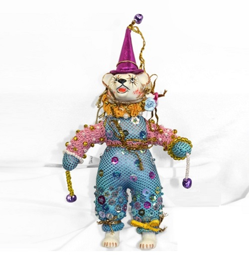 Bear-clown. Christmas handmade decoration with the elements of the porcelain