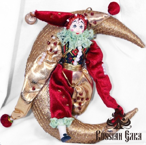 Clown on the moon. Christmas handmade decoration with the elements of the porcelain