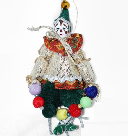 Clown with beads. Christmas handmade decoration with the elements of the porcelain