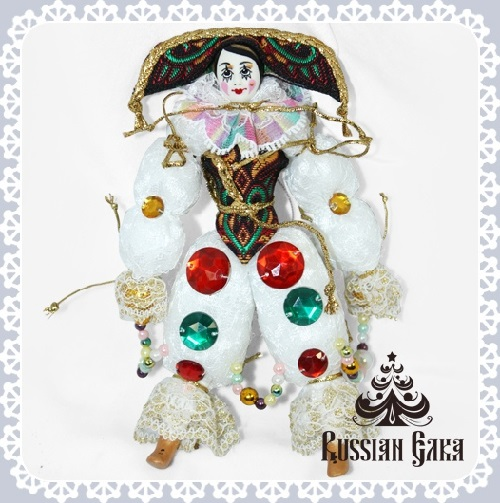 Clown. Christmas handmade decoration with the elements of the porcelain