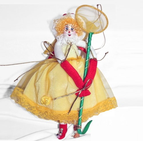 Clowness with a butterfly net. Christmas handmade decoration with the elements of the porcelain