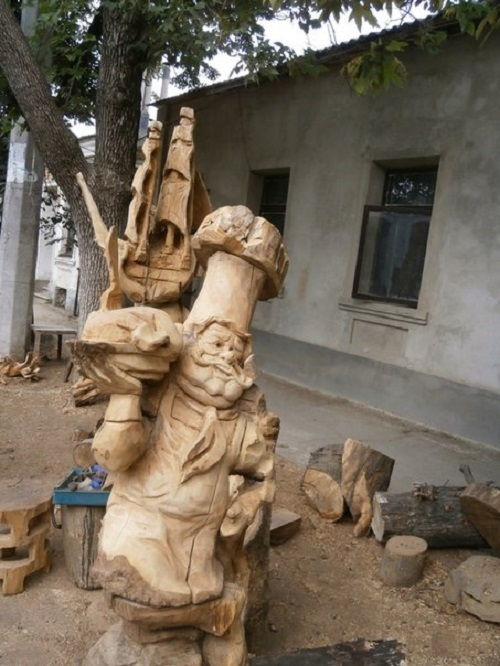 Dry trees carved sculpture in Simferopol, Russia. Art work by wood carver Igor Dzheknovarov