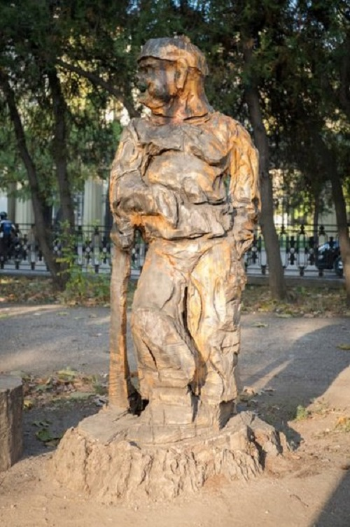 Dry trees carved sculpture in Simferopol, Russia. Art work by Crimean self-taught artist Igor Dzheknovarov