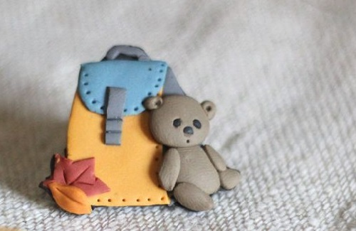 First day at school. Brooch. Made of polymer clay in the author's technique of patchwork modeling